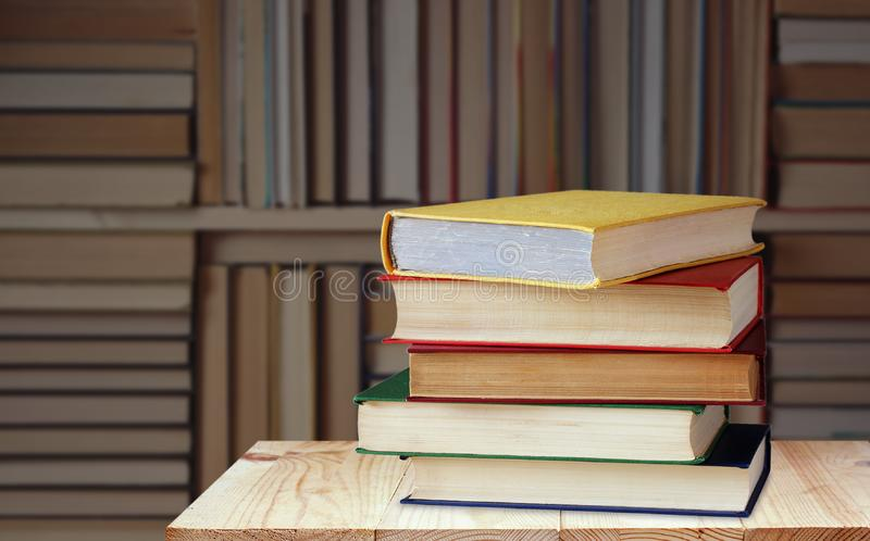 Shelf with books against the blurred background of the library, the bookcase stock photos