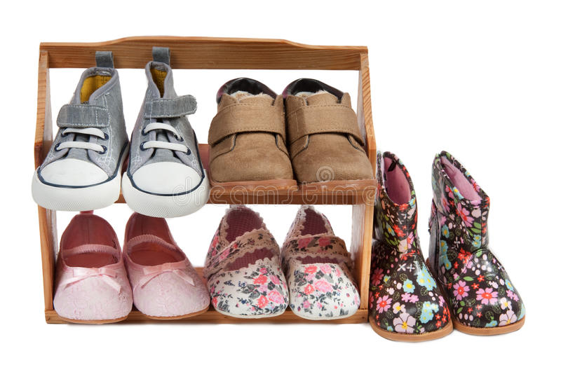 Shelf of children shoes for all occasions isolated royalty free stock image