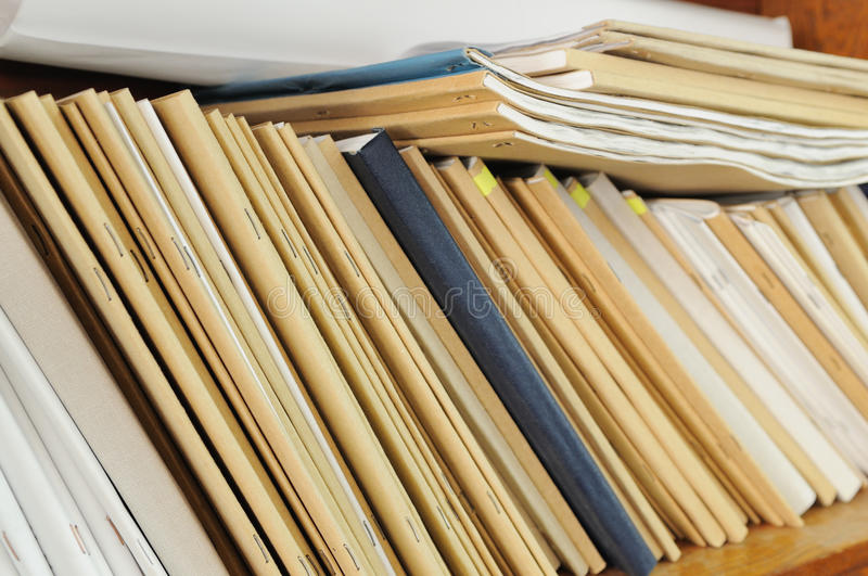 Shelf with file folders. Wooden shelf with file folders, archival documents stock photos