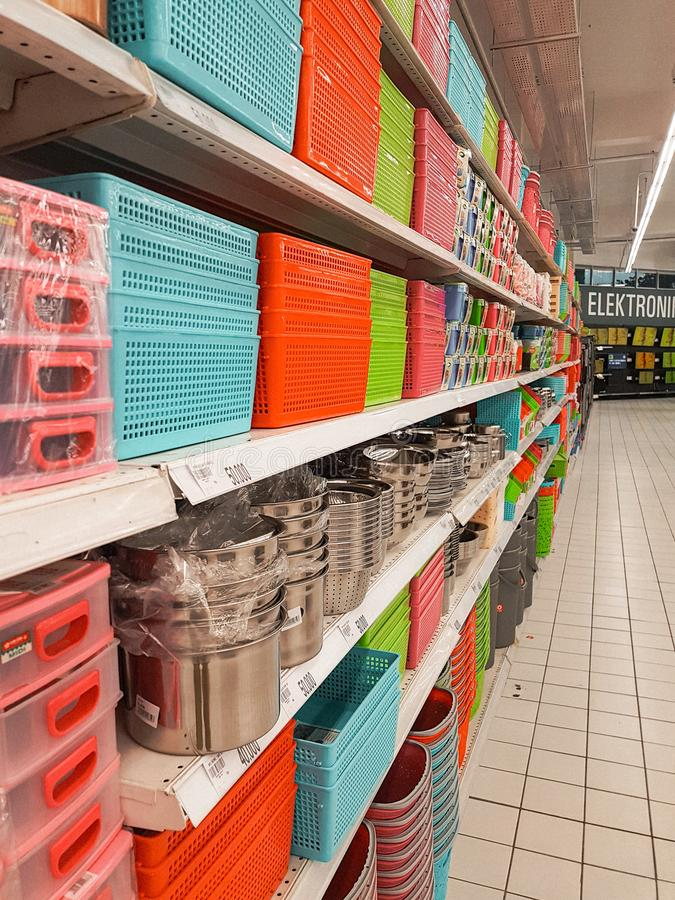Shelf full of plastic basket and steel pot. In Giant supermarket, Alam Sutra, Tangerang. Indonesia, asian, south, east, shop, store, display, rack, home royalty free stock photography