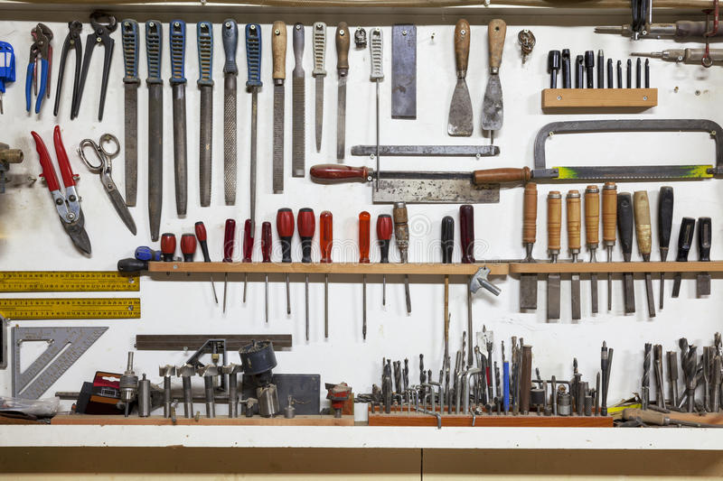 Shelf with hand tools stock images