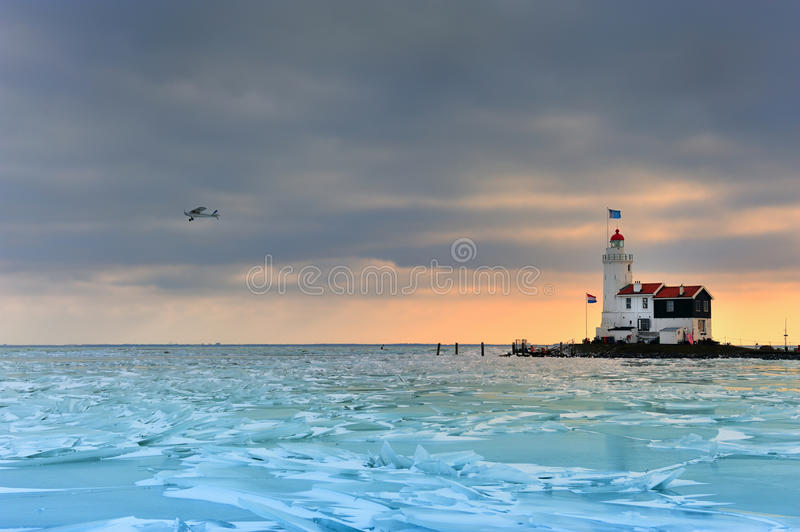 Shelf ice and lighthouse in Marken. A small village near Amsterdam The Netherlands royalty free stock photography