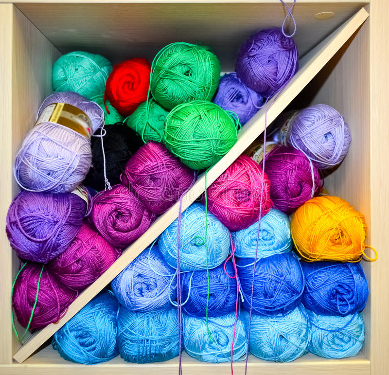 Shelf with knitting yarn balls. Shelf with colorful colors wool yarn balls on shop display stand for sale royalty free stock photography
