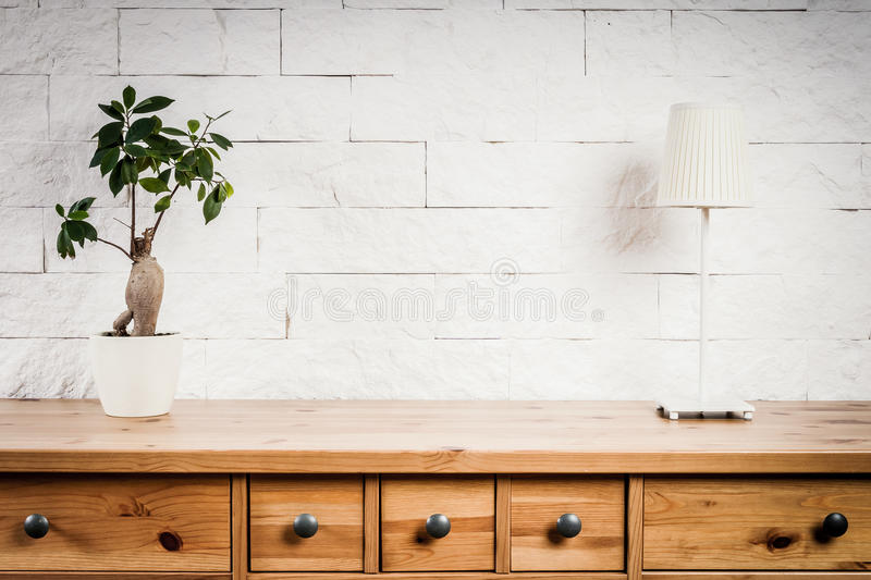 Shelf with lamp and flower and white wall. Shelf with a lamp and flower and a white brick wall stock images