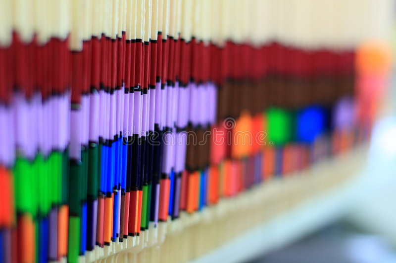 Shelf of Medical Records. Colorful medical records line the shelf in this doctor's office stock image