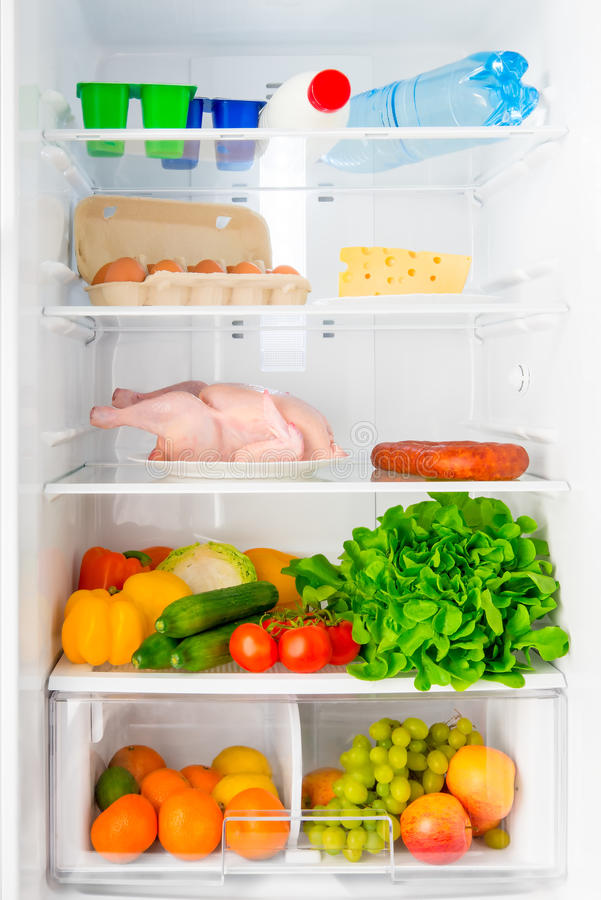 Shelf of the refrigerator with food. Domestic refrigerator stocked with fresh and healthy food stock photo