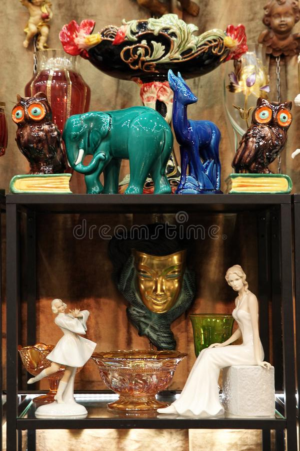 Shelf with vintage figurines stock images
