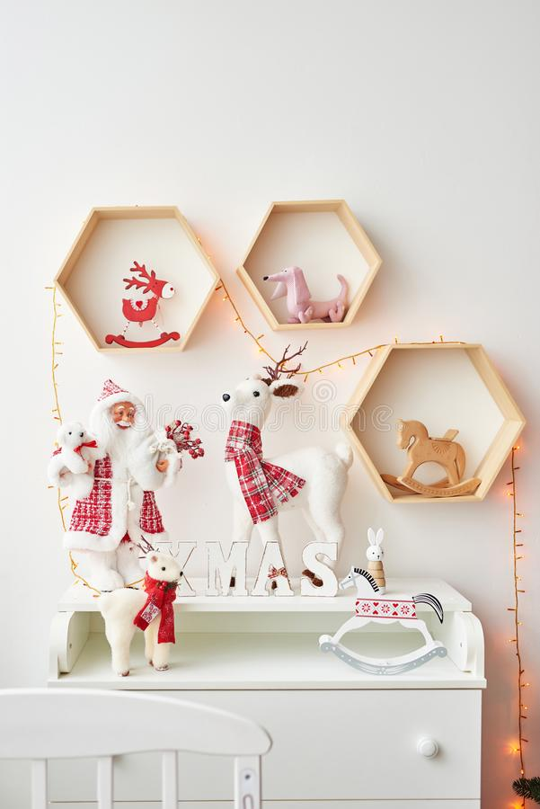 Free Shelf With Christmas Figures Santa And Deer In Children`s Room. Christmas Interior Of Children`s Bedroom. New Year`s Decor And Tre Stock Photos - 163314703