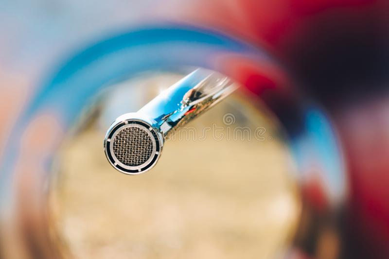 shell, colorful, bottom view. faucet aerator, close up. background blue sky royalty free stock photography