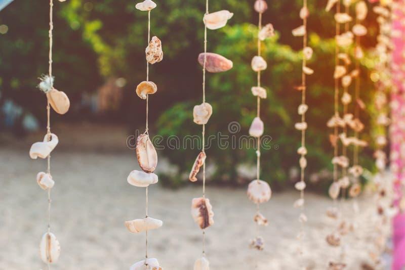 Shell curtain on the beach. Colourful shell curtain on the sand beach royalty free stock photography