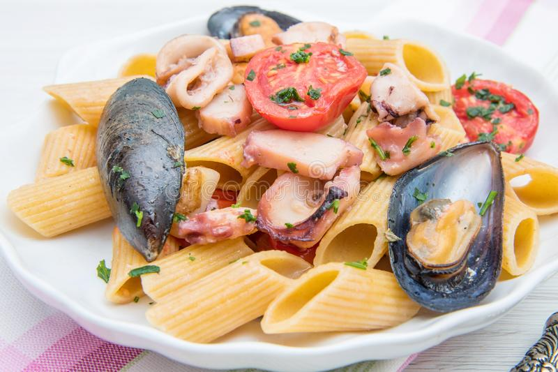 Shell dish with pasta and seafood. A shell dish with pasta and seafood stock photos