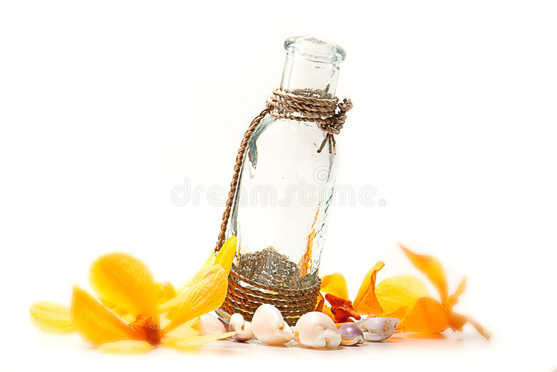 Shell and Flower with Water bottle. Shell and Flower Water bottle isolate with white color stock photo