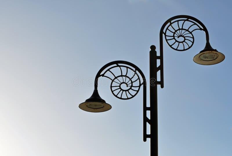 Shell formade ljus Lyme Regis Dorset arkivfoton