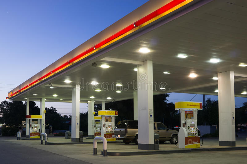 Shell Gas Station. JACKSONVILLE, FL-MAY 16, 2014: A Shell gas station in early morning in Jacksonville. According to Forbes, Royal Dutch Shell oil company is the stock photos