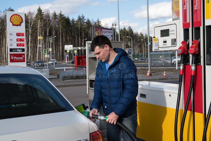 Shell gas station man fills car with gasoline stock image
