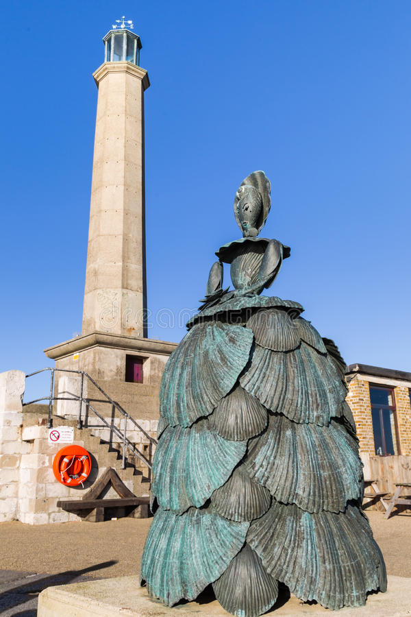 Shell Lady of Margate. Margate, Kent - December 10, 2014: Mrs Booth the Shell Lady of Margate, a 12 foot bronze sculpture by Ann Carrington. Sophie Booth was royalty free stock photo