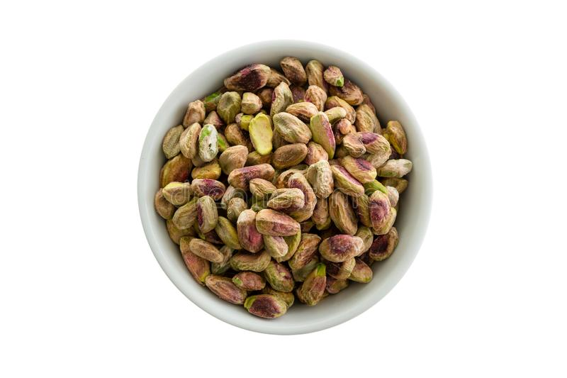 Shelled roasted fresh pistachio nuts in a bowl stock photos