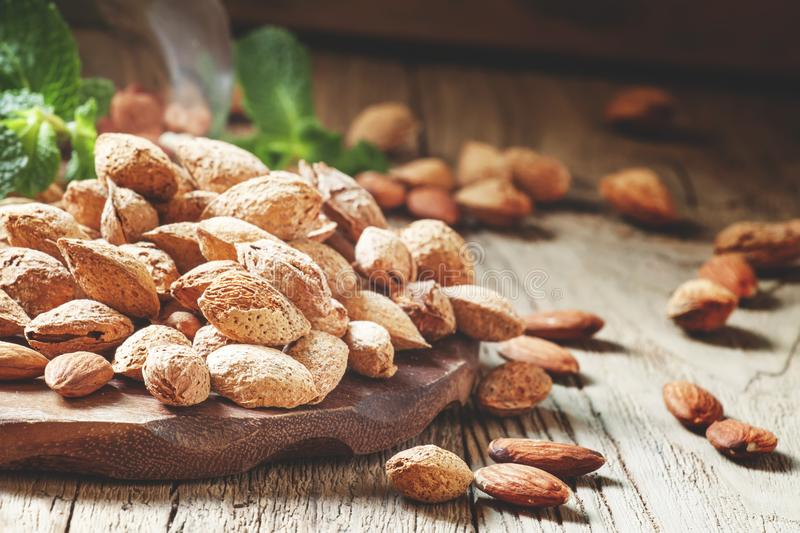 Shelled and unshelled almonds, selective focus royalty free stock photo