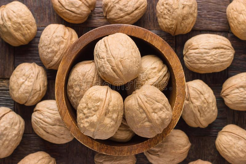 Shelled walnut in wooden bowl, top view stock photography