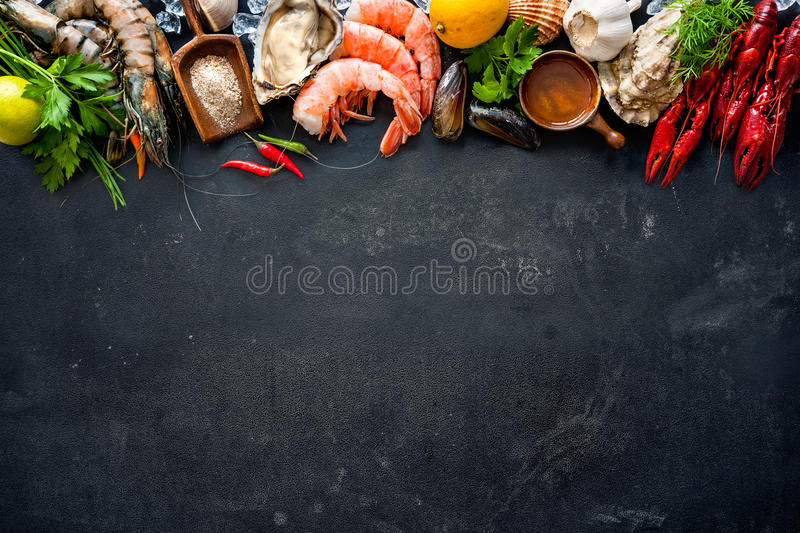 Shellfish plate of crustacean seafood. With shrimps, mussels, oysters as an ocean gourmet dinner background royalty free stock photo