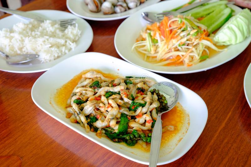 Shellfish stir fielded basil in plate, papaya salad, and rice stock photo