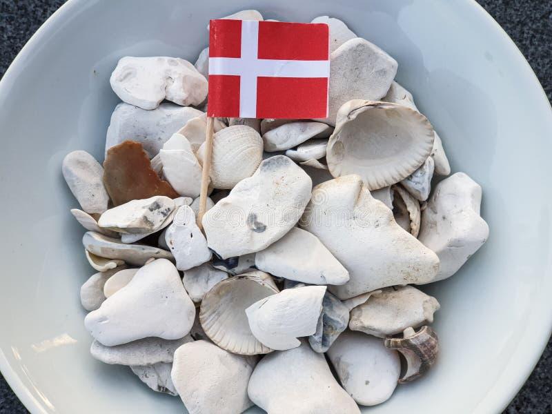 Shells, white stones and a danish flag. Nature, beach, sand, coast, sea, travel, ocean, seascape, water, denmark, copenhagen, beautiful, holiday, dune, natural royalty free stock photos