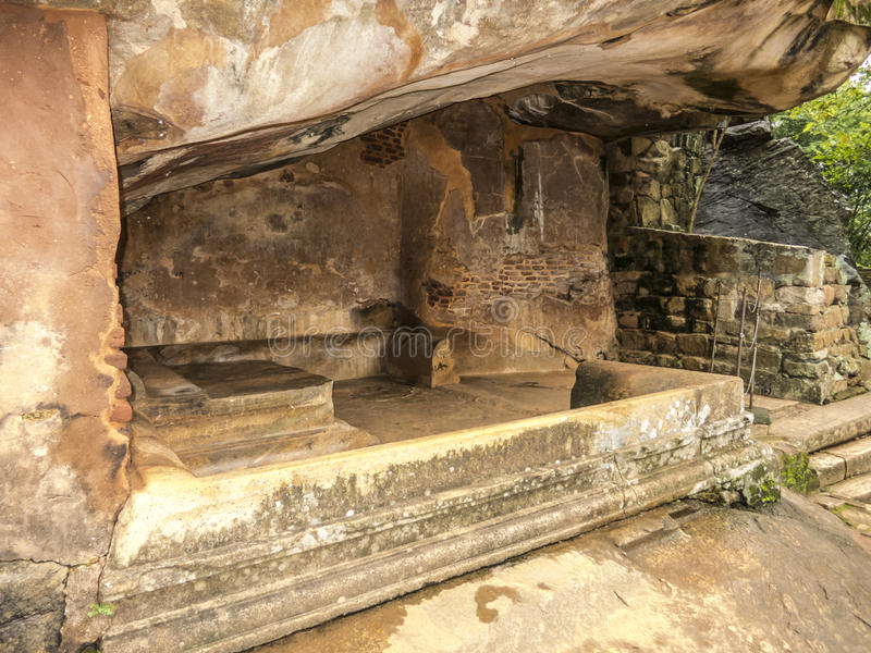 Shellter in old kingdom in Sri Lanka. Seating area protected by the cliff stone near stairs to old kingdoom stock photo