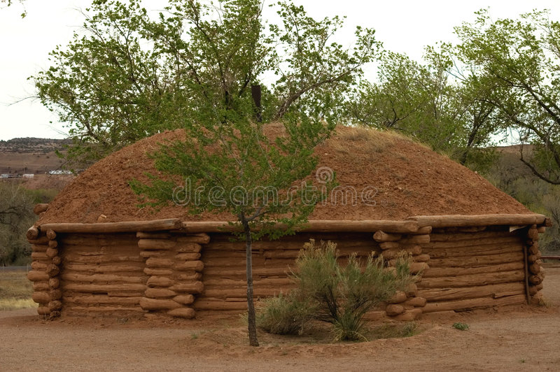 Shelter. Typical Navajo house made with logs and energetic roof , Arizona, USA royalty free stock images
