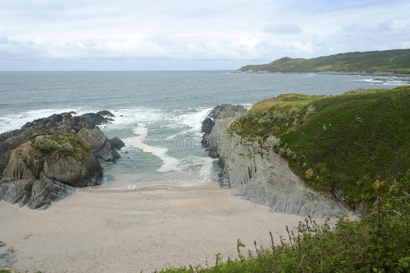 Woolacombe Beach in a Cove of Rocks stock images