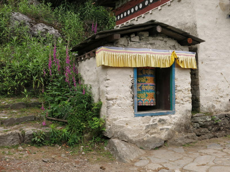 Sheltered prayer wheel in the Everest Region stock photo