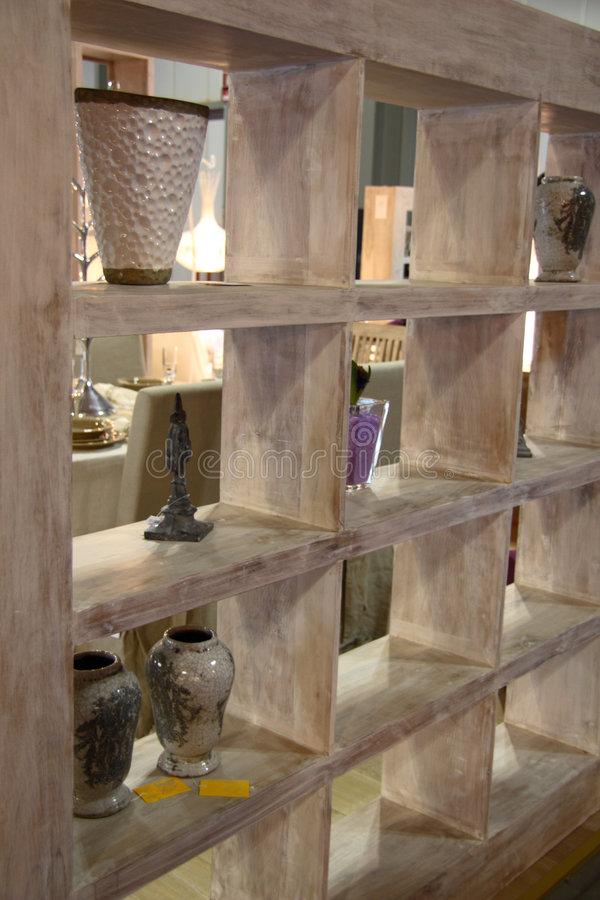 Shelves. In light wood used as a divider between local royalty free stock images