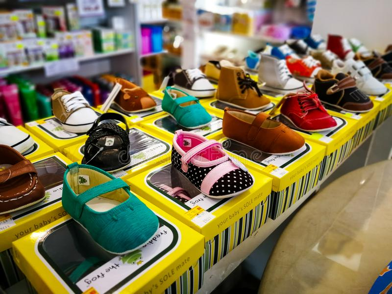 Shelves with Assortment of baby shoes in the store for sale. royalty free stock image