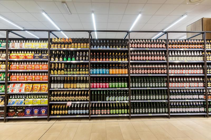 Shelves with beer varieties of different brands and types. stock photo