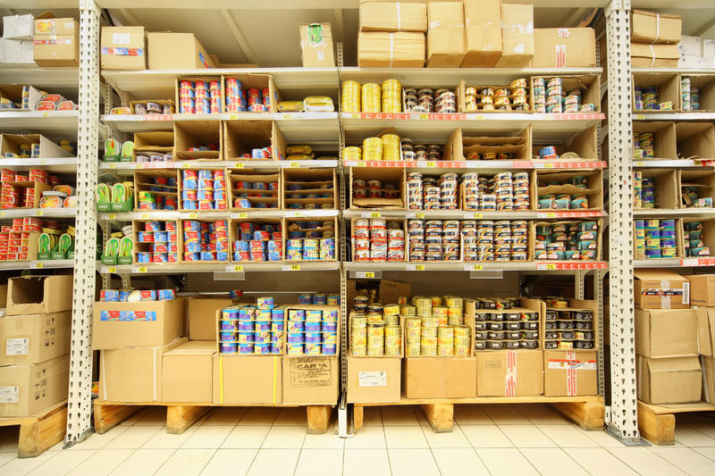 Shelves with canned fish in shop royalty free stock photo