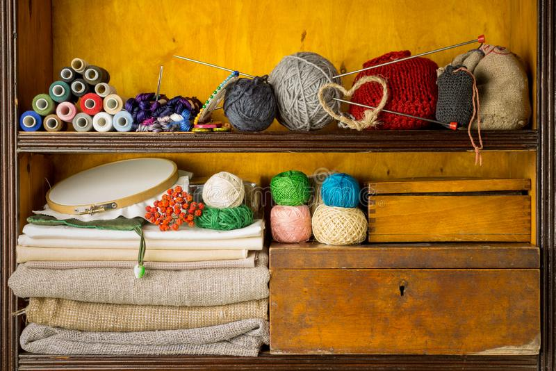 Shelves filled with materials and tools for handmade, embroidery and knitting royalty free stock photography