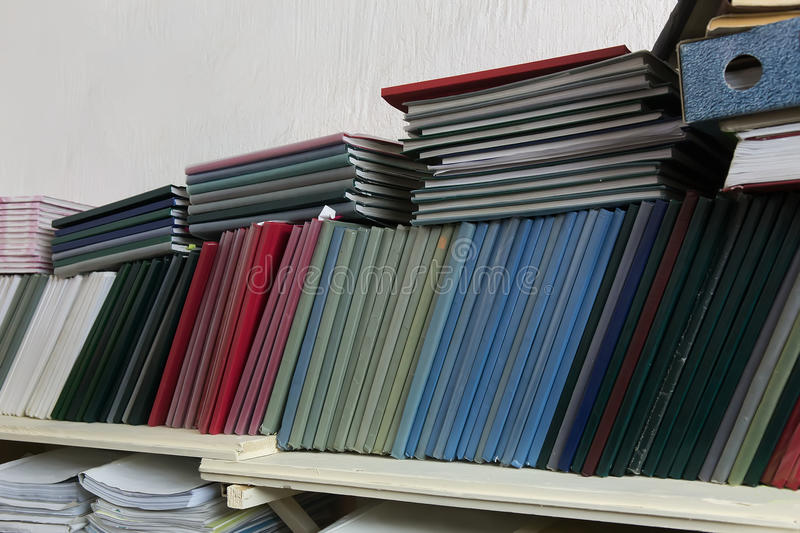 Shelves with folders with documentation. Close-up royalty free stock images