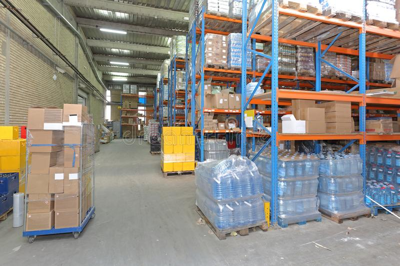 Food Warehouse. Shelves With Food and Drinks in Distribution Warehouse stock photos