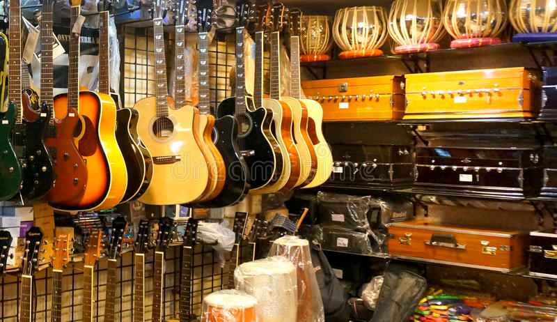 Shelves with Indian & western musical equipment royalty free stock images