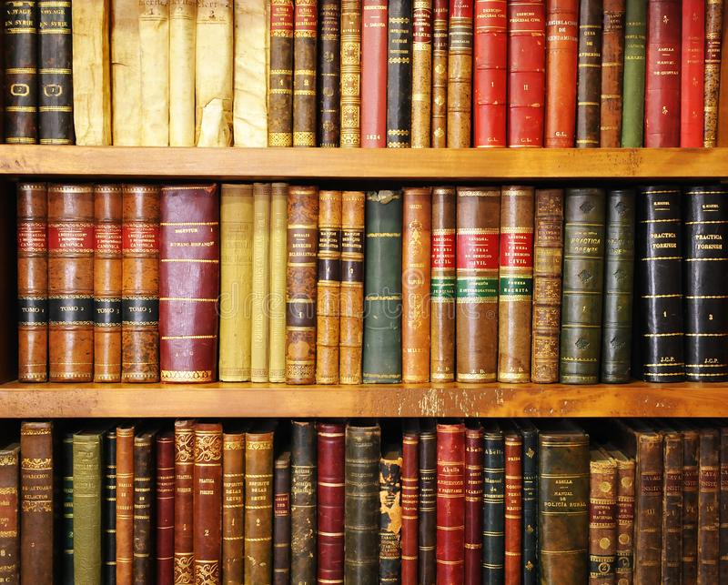 Wooden bookshelf with antique books in a library. A treasure of human knowledge royalty free stock photos