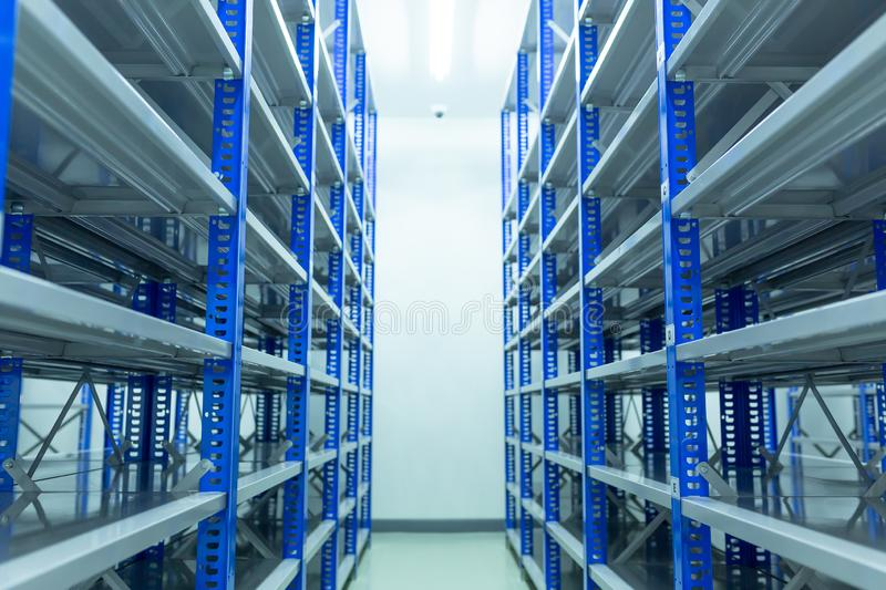 Shelves, Inside the spare room With shelves prepared for storing auto spare parts, spare room, Factory warehouse spare parts.  stock photo