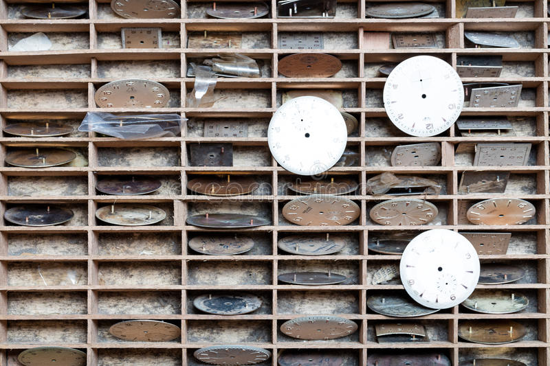 Shelves with quadrants in a clockmaker shop. Closeup of mini shelves with quadrants in a clockmaker shop royalty free stock photo