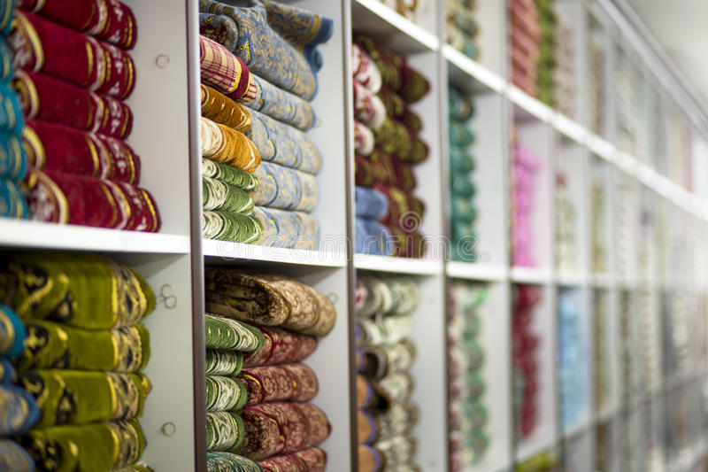 Shelves with rugs royalty free stock photography