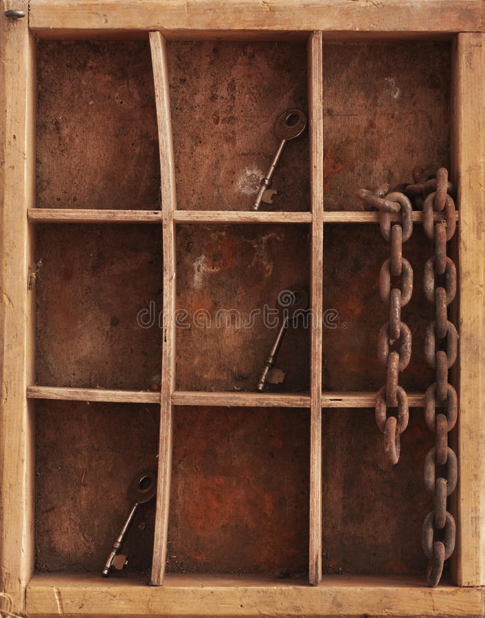 Shelves whith keys and chain. A still life composition with old dusty shelves with three keys and a rusty chain stock image