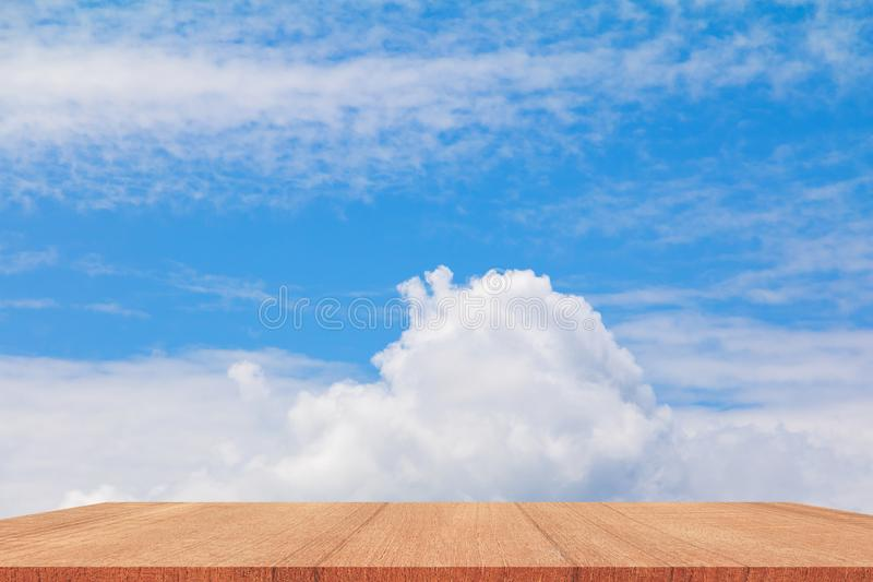 Shelves wood floor top empty with blue sky cloud vivid background. Art of nature beautiful for present your products royalty free stock image