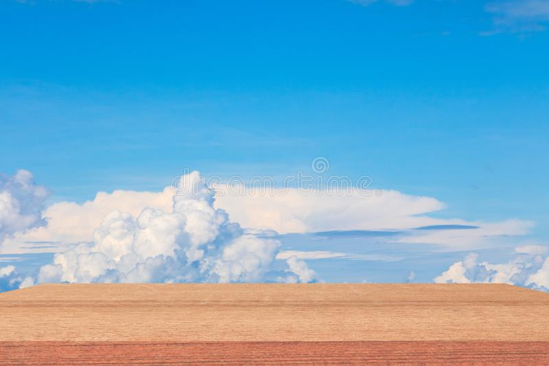 Shelves wood floor top empty with blue sky cloud vivid background. Art of nature beautiful for present your products stock photo