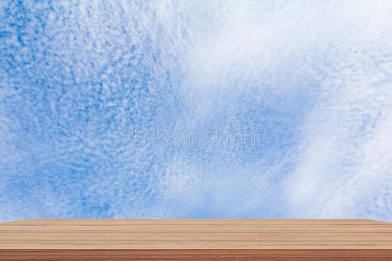 Shelves wood floor top empty with blue sky cloud vivid background. Art of nature beautiful for present your products stock image