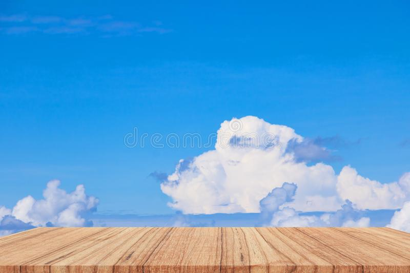 Shelves wood floor top empty with blue sky cloud vivid background royalty free stock photography