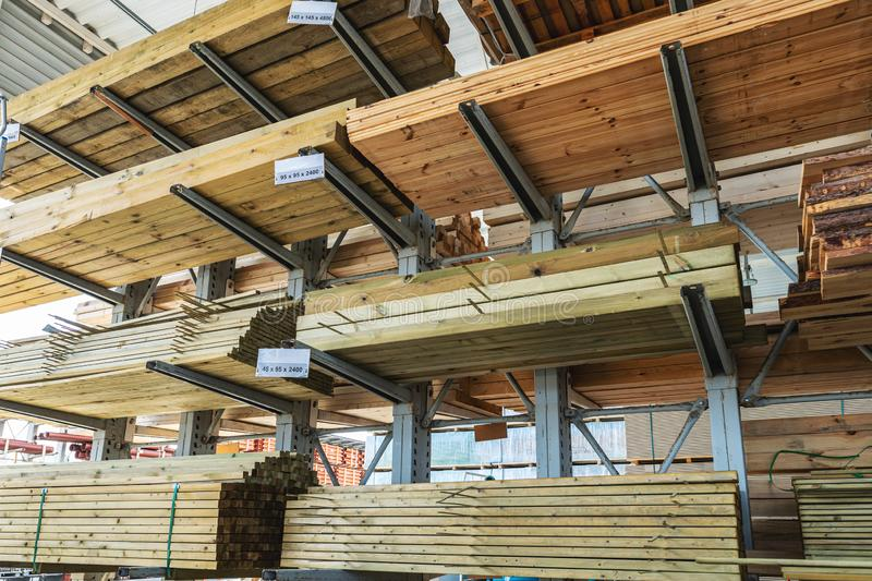 Shelves with wooden boards at building material store. Shelves with wooden boards and planks at building material store stock photo