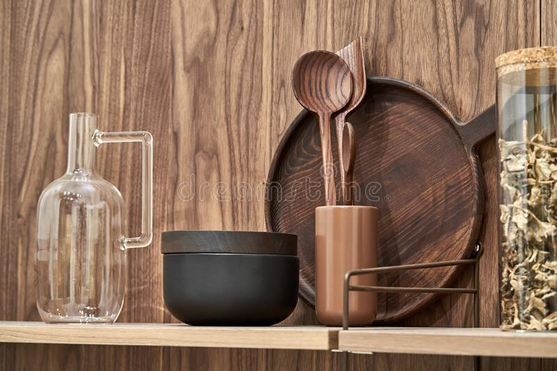 Shelves with wooden and ceramic and glass dishes royalty free stock photos