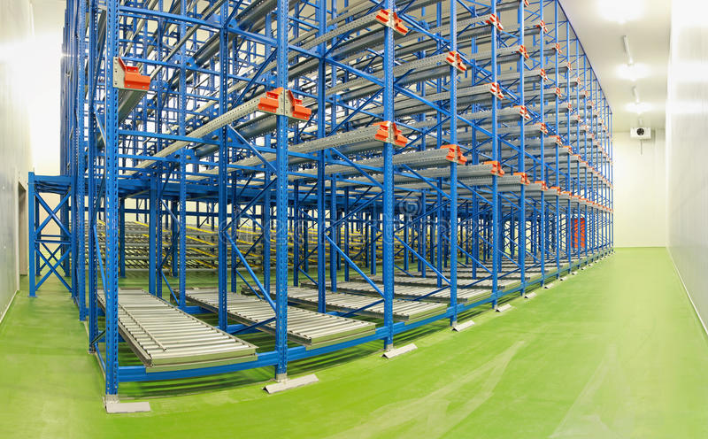 Shelving system warehouse. Empty shelving system in new distribution warehouse royalty free stock photography
